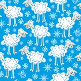 Seamless pattern cute christmas sheep. With snowflakes Stock Photos