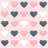 Seamless pattern with cute colorful hearts on a pink Royalty Free Stock Photos