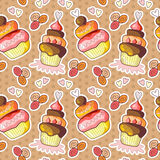 Seamless pattern with cute cupcakes on dot background. Stock Photo