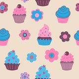 Seamless pattern with cute cupcakes and flowers. Seamless pattern with a cute cupcakes and flowers Royalty Free Stock Images