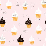 Seamless pattern with cute cupcakes. Modern creative background with cupcake and hand drawn elements. Stock Photography
