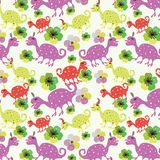 Seamless pattern with cute dinosaurs and flowers. 