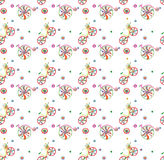 Seamless pattern with cute doodle bicycles. With flowers. Vector illustration, background, wallpaper, textile, texture Stock Photos