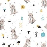 Seamless pattern with cute doodle rabbits royalty free stock photos