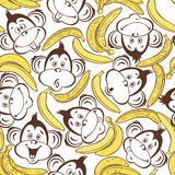 Seamless pattern with cute faces of monkeys and bananas. Cartoon Stock Photography