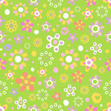 Seamless pattern with cute flowers. Seamless pattern with cute funny cartoon flowers and herbs on green background. The good choice for childrens accessories Royalty Free Stock Images