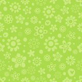 Seamless pattern with cute flowers in green monochrome colors on green background. Seamless pattern with cute funny cartoon flowers and herbs in green Stock Images