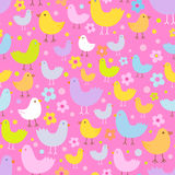 Seamless pattern with cute funny cartoon birds. Stock Photos
