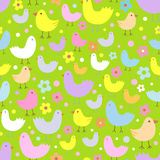 Seamless pattern with cute funny cartoon birds. Stock Images