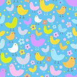 Seamless pattern with cute funny cartoon birds. Royalty Free Stock Image