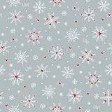 Seamless pattern with cute hand drawn snowflakes and little red hearts royalty free stock images