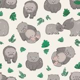 Seamless pattern with cute hand drawn wombats and green leaves. Backdrop with funny adult and baby animals on light Stock Images