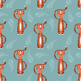Seamless pattern with cute jungle orange tiger on blue background Royalty Free Stock Images