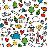 Seamless pattern with cute little doodle drawings  on wh Royalty Free Stock Photo
