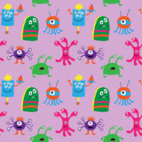 Seamless pattern with cute monsters on a pink background Royalty Free Stock Photo