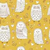 Seamless pattern with cute owls, flowers and hearts. Royalty Free Stock Photography