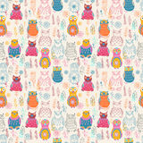 Seamless pattern with cute owls and flowers Royalty Free Stock Photo