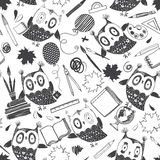 Seamless  pattern with cute owls and school supplies on a Stock Image