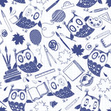 Seamless  pattern with cute owls and school supplies on pa Stock Photography