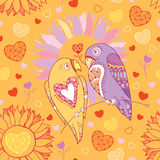 Seamless pattern with cute parrots in love and flowers on the orange background Stock Image