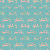 Seamless pattern with cute pink bicycles tandem on blue background. Vector illustration for your design Royalty Free Stock Photos