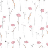 Seamless pattern with cute pink flowers. White background with stylized doodle flowers. Royalty Free Stock Photo