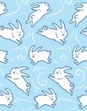 Seamless pattern with cute rabbits shapes. Seamless pattern with cute bunnies. White cute rabbits isolated on blue background. Hand drawn shapes. Childish Stock Image