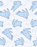 Seamless pattern with cute rabbits shapes. Seamless pattern with cute bunnies. Blue cute rabbits isolated on white background. Hand drawn shapes. Childish Royalty Free Stock Photos