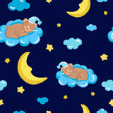 Seamless pattern with cute sleeping teddy bear, clouds, stars and moon. Stock Photography