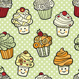 Seamless pattern with cute smiling cupcakes on green dotted background. Royalty Free Stock Photography