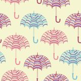 Seamless pattern with cute umbrellas. Vector Royalty Free Stock Images