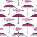 Seamless pattern with cute umbrellas. Vector illustration. Girly fashion background. Graphic cartoon retro texture. Vintage weathe Stock Images