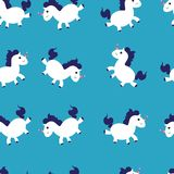 Seamless pattern with cute unicorn vector illustration on blue background. Colorful vector illustration for fabric print, vector illustration