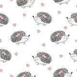 Seamless pattern with cute watercolor hedgehogs and hearts. Royalty Free Stock Photography