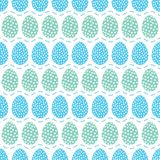Seamless pattern of dark blue easter eggs with lines pattern. Seamless pattern of dark blue diamond shaped Easter eggs on a check background with blue dashed Stock Photo