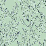 Seamless pattern of dark outline leaves on an green background Stock Photos