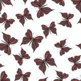 Seamless pattern with dark red butterflies on the white background. Royalty Free Stock Images