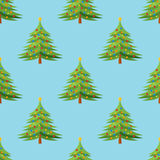 Seamless pattern with decorated Christmas tree on blue background Royalty Free Stock Image