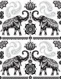 Seamless pattern with decorated elephants. And lotus flower Stock Images