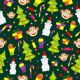 Seamless pattern with decorated trees and gifts Stock Images