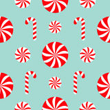 Seamless Pattern Decoration. Christmas Candy Cane Round white and red sweet set. Wrapping paper, textile template. Blue background. Flat design. Vector royalty free illustration