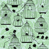 Seamless pattern with decorative bird cage Silhouettes. On floral background. Ready to use as swatch Stock Photo