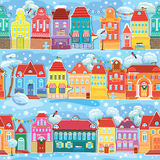 Seamless pattern with decorative colorful houses in winter time. Stock Photo