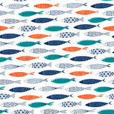 Seamless pattern from decorative fish. Vector Stock Photos