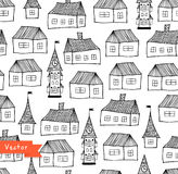 Seamless pattern with decorative houses in pastel colors. City background.  Royalty Free Stock Images