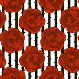 Seamless pattern of decorative red roses on a striped black and. White background.Vector Royalty Free Stock Image