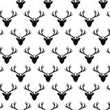 Seamless pattern with deer heads silhouettes. Vector seamless texture for wallpapers, pattern fills, web page backgrounds royalty free illustration