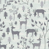 Seamless pattern with deer in winter forest. Deer in winter forest. Seamless pattern with hand drawn design for Christmas and New Year greeting cards, fabric Stock Images
