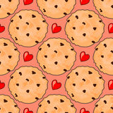 Seamless pattern with delicious chocolate chip cookies and red hearts. Stock Photo