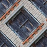 Seamless pattern of wooden window shutters. Seamless pattern for designers with old wooden window shutters on grey brick wall stock photos